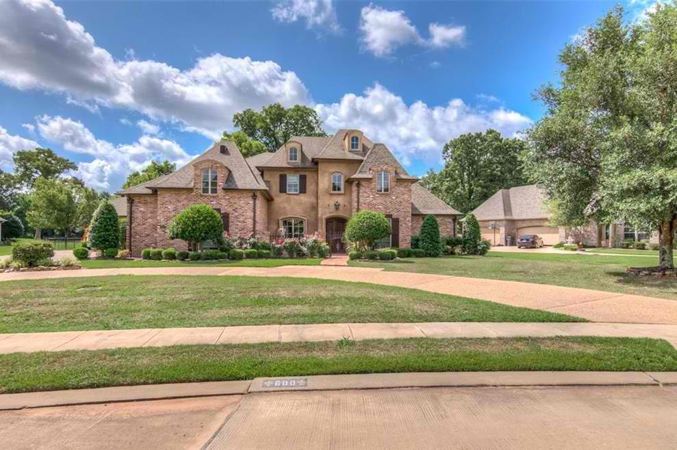 Stunning home with comfortable and multiple living areas and endless amenities! Pinewood floors, interior brick walls, special ceiling treatments, inviting hearth room, relaxing media room, entertaining formal dining room, game room, office, flagstone patio overlooking a very large fenced in yard on the golf course.